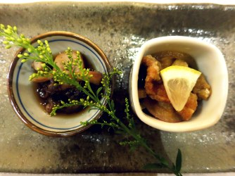 Small dishes of salmon and octopus