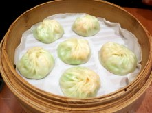 A vegetable and shrimp variation of the xiao long bao